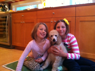 Truman at home with the girls.