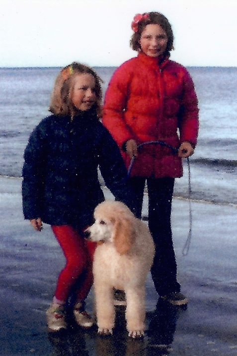 Truman and the girl walking on the beach.